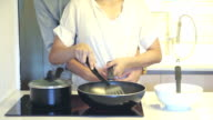 HD : Young couple is cooking