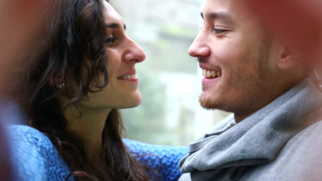 Young couple kissing and laughing