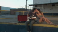 SLO MO, MS, Young couple kissing, man playing guitar, Los Angeles, California, USA