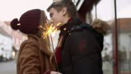 SLO MO Young couple kissing with the sparkler
