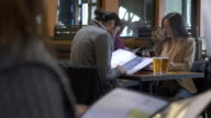 Young couple looking at a menu in a bar