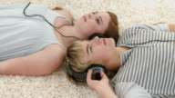 CU Young couple lying on floor and listening to music / Cape Town, South Africa