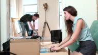 Young Couple Moves In to New Apartment
