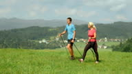 HD DOLLY: Young Couple Nordic Walking