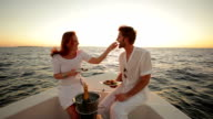 young couple on a sunset boat trip