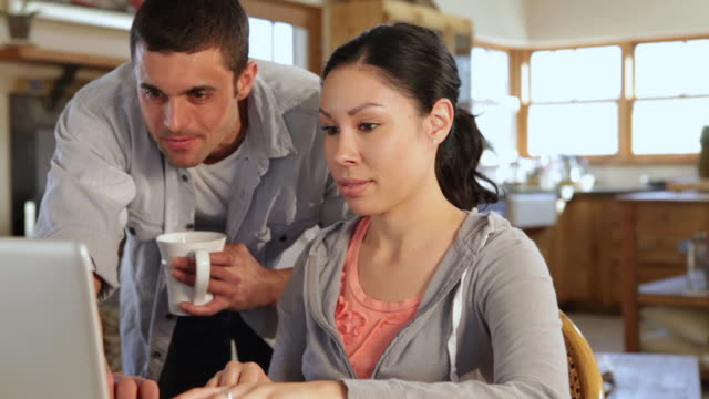 MS TU Young couple paying their bills online / Lamy, New Mexico, United States