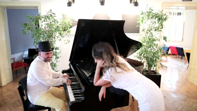 Young couple playing the piano in a restaurant