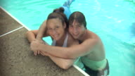 CU, HA, Young couple relaxing in swimming pool, portrait, Middlesex, New Jersey, USA