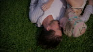 Young couple roll around in a park