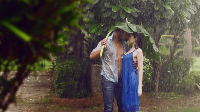 Young Couple Romancing In Rain Season Delhi India Stock
