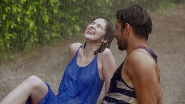 Young couple romancing in the rain, Delhi, India
