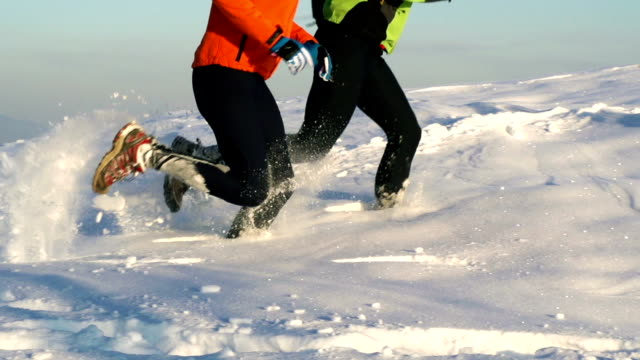 HD: Young couple running in the snow