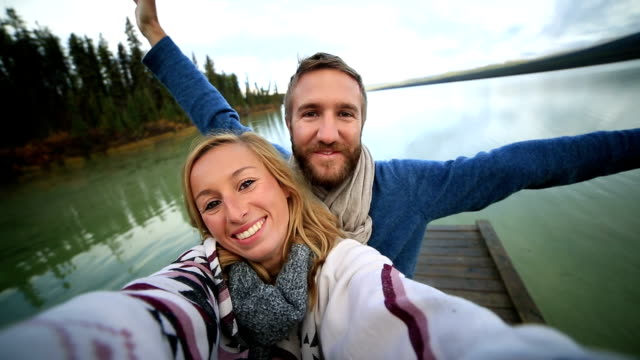 Young couple selfie by the lake