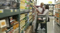 Young couple shopping in a warehouse supermarket
