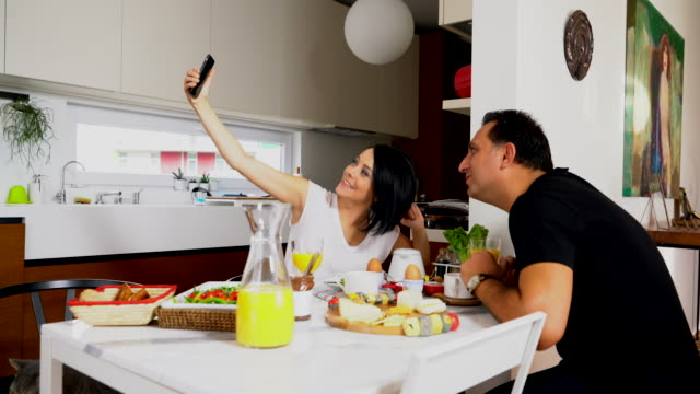 young couple taken selfie at home