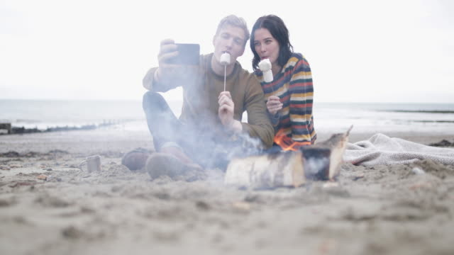 Young couple taking a selfie of their winter break
