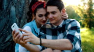 Young couple taking a selfie on a picnic