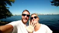 Young couple taking selfie portrait in Toronto-Summer