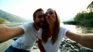 Young couple taking selfies outdoors