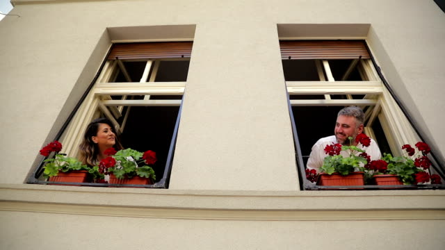 Young couple together on the window
