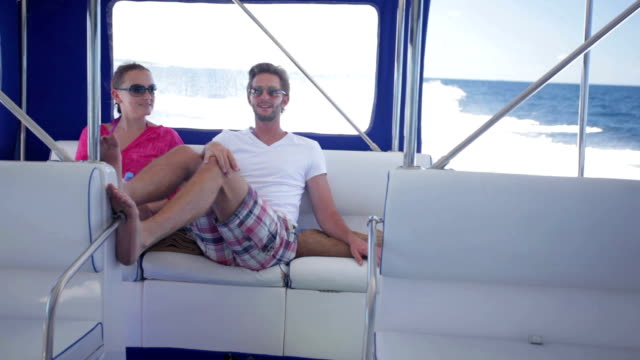 young couple travelling with speed boat