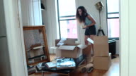 Young Couple Unpacks Boxes in New Apartment