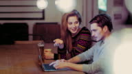 DS Young couple using laptop at home