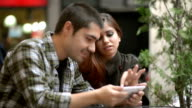 Young couple using smart phone