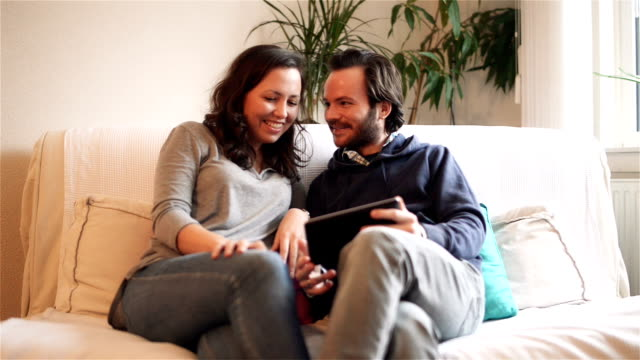 DOLLY: Young couple video chatting with tablet computer