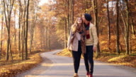 Young couple walking in the forest