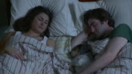 CU HA Young couple with puppy sleeping in bed / Brooklyn, New York City, New York, USA