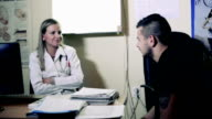 Young doctor chatting with patient