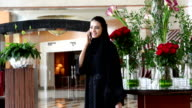 Young Emirati woman by the red roses