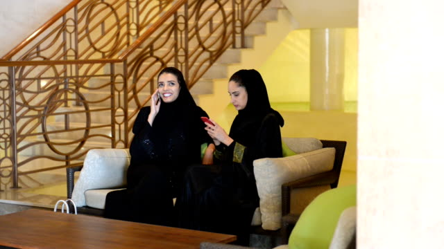 Young Emirati women in the SPA lobby