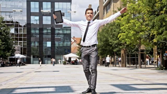 SLO MO Young executive skateboarding in the city