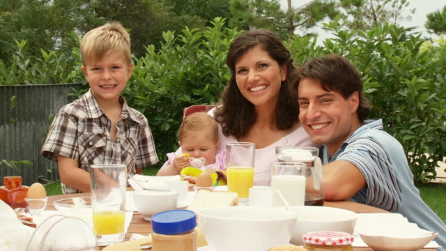 HD DOLLY: Young Family At Breakfast