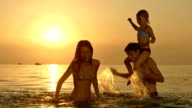 HD: Young Family Having Fun In The Sea