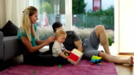 young family relaxing in living room
