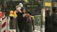 A young family walks through Berlin.