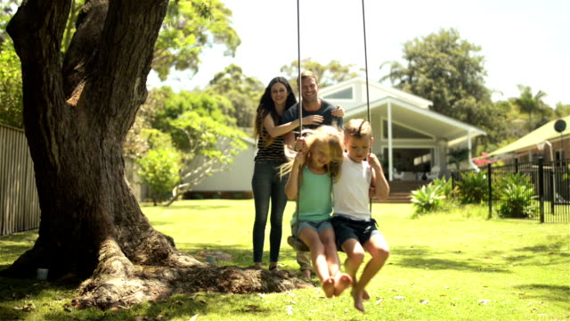 DOLLY: Young family with kids having fun