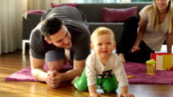 young family with toddler at home