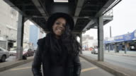 A young, fashionable black woman on the move in Brooklyn, New York City - 4k