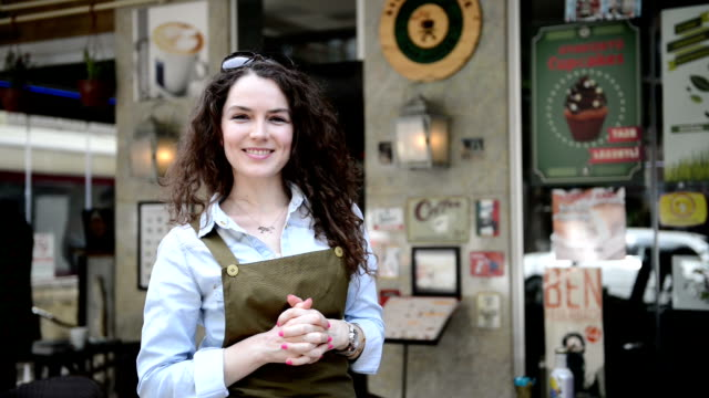 Young female coffee shop owner