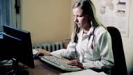 Young Female Doctor working in the office