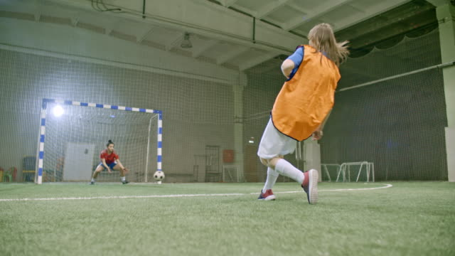Young female goalie missing penalty kick