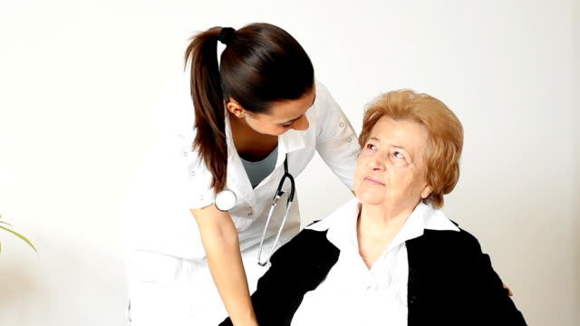 Young female nurse with her senior female patient.