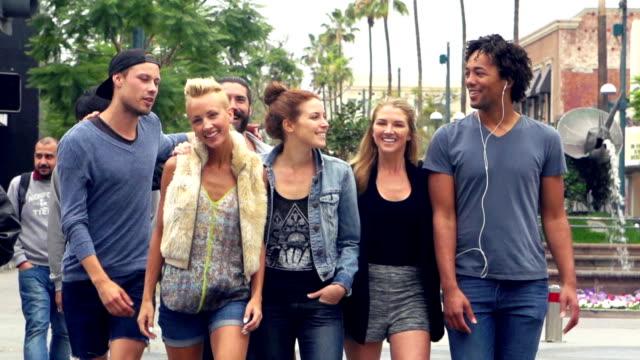 SLOW MOTION - Young Friends Having Fun on Santa Monica Street, Los Angeles.