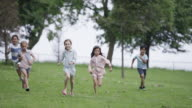 Young Friends Jogging through Park
