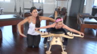 'MS Young girl doing gyrotonics with instructor / Beverly Hills, California, United States'