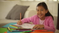 MS PAN Young girl drawing at home.